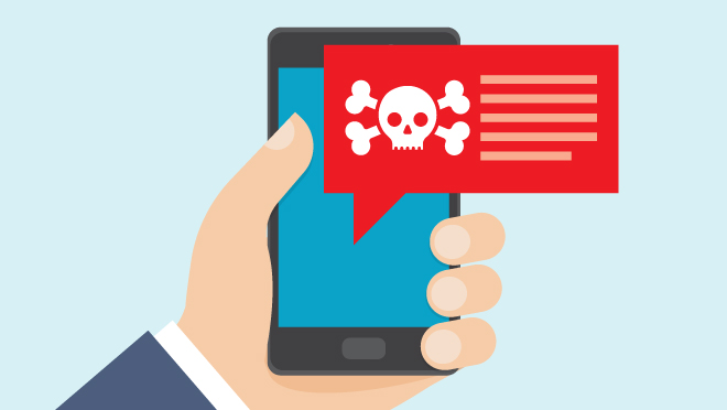 Hand holding smartphone shows text with skull and crossbones warning.