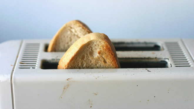 Image of fresh toast popping from an old toaster