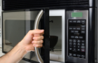 using-microwave-hand-people.jpg