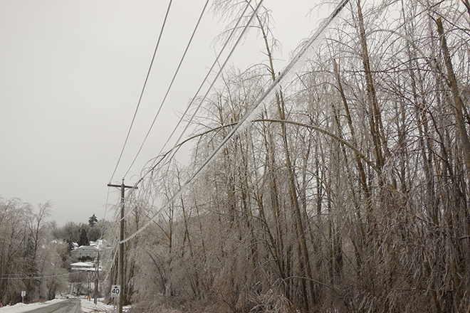 Ice covered power lines during winter snow storm