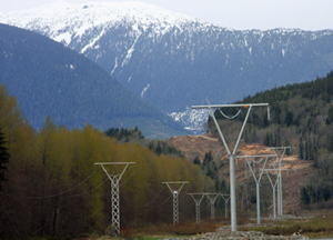 The new Northwest Transmission Line (NTL) 287 kV line is on the right and the existing 138 kV line from Skeena to Stewart is on the left. The view is looking north toward the Skeena River crossing.