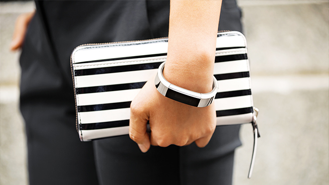 Image of a woman wearing a Fitbit Alta