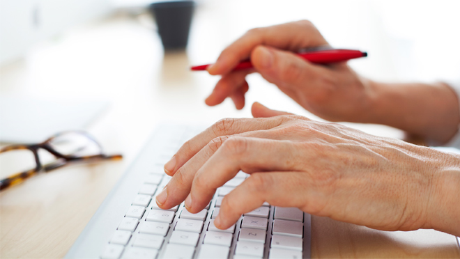 Image of person using a computer keyboard
