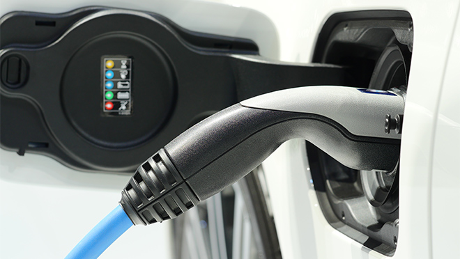 Image of a charger plugged into an electric vehicle