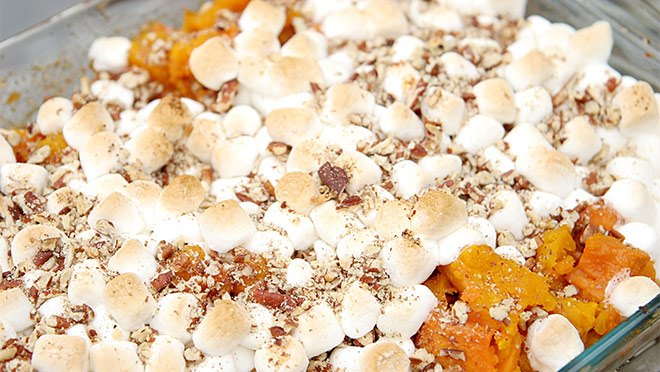 Up-close photo of a dish of sweet potato and marshmallow casserole