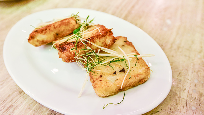 Photo of turnip cakes, a popular dish served in Cantonese cuisine