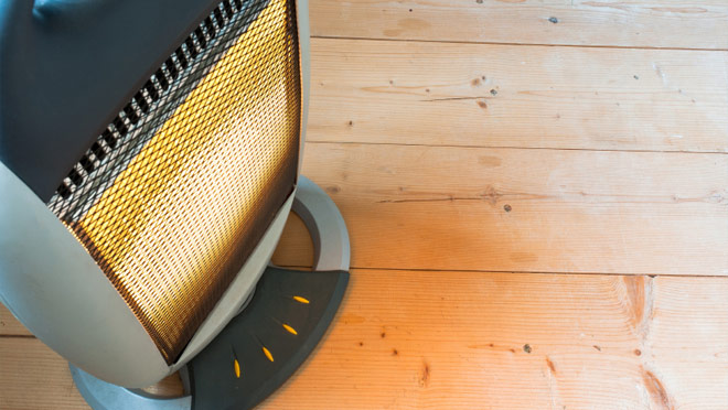 Image of an electric heater on wooden floor