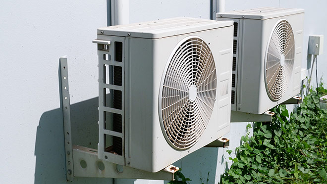 Image of heat pumps on the side of a building