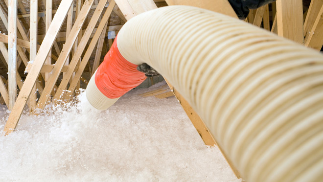 Image of insulation being sprayed in a house attic