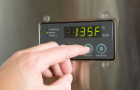 Tankless hot water heating thermostat with hand