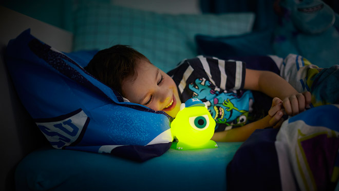 Image of boy with glowing Disney Soft Pal