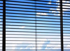 Blue sky through window blinds