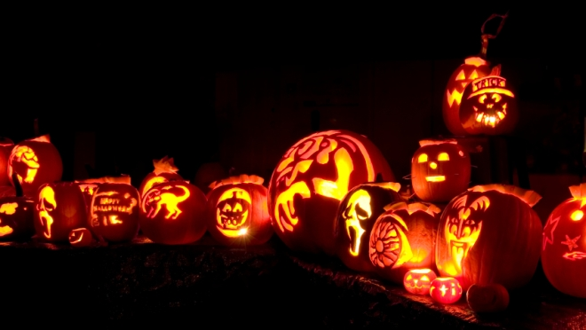 Jack-o-lanterns, lit up at night