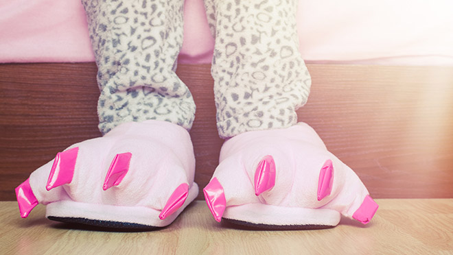Image of young girl wearing pink animal slippers