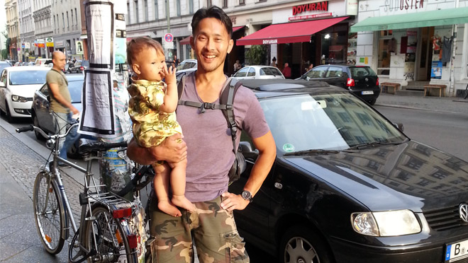 Image of Allan Wong with his child