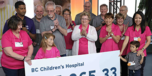 Power Pioneers and BC Hydro donating cheque to BC Children's Hospital Miracle Campaign