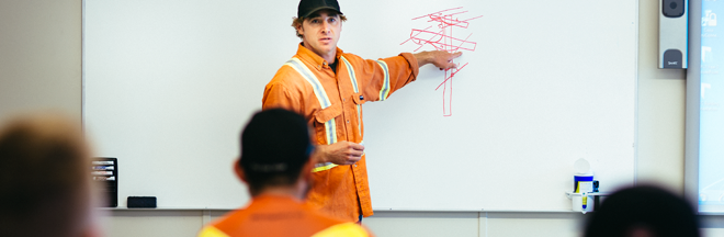 Power line technician in classroom training apprentices
