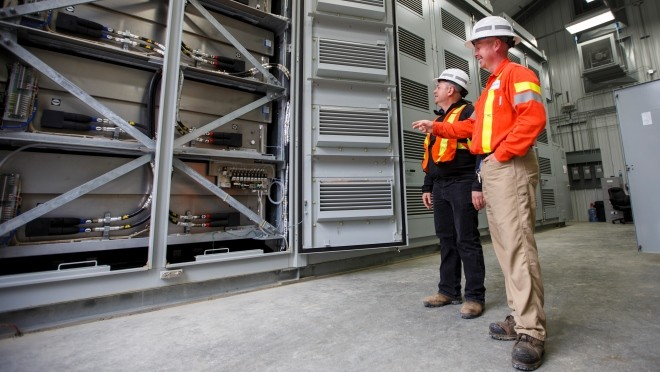 Trevor Wareham, BC Hydro Electrician Sub foreman and Vlad Kositsky, BC Hydro Project Manager inspect one of four banks of sodium-sulphur battery modules.