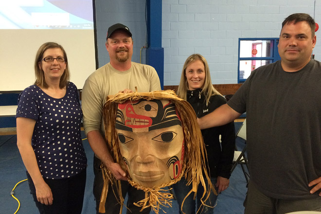 BC Hydro's Melissa Prouse, Jeff Nelson, Lia Wallace and Dan Davies pose with Haislan Mask