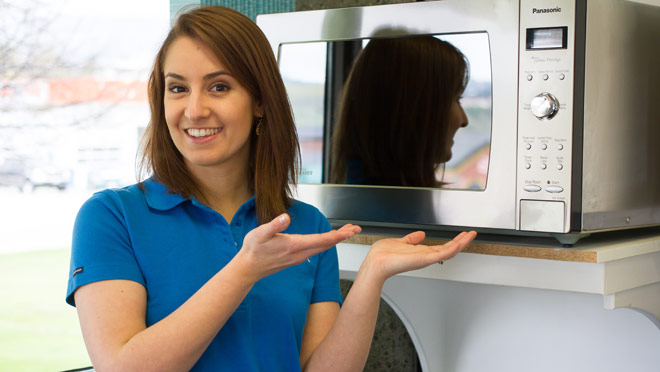 Image of BC Hydro's Kelsey McMorran with a microwave oven