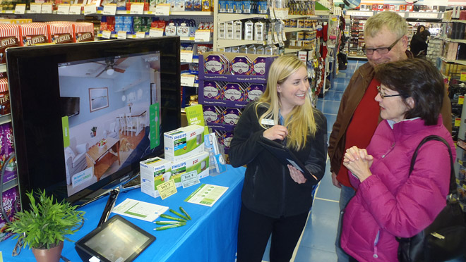 Image of BC Hydro representative and customers at a London Drugs retail event