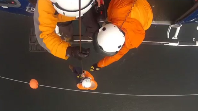 BC Hydro crew inspects warning markers above Sansum Narrows from helicopter