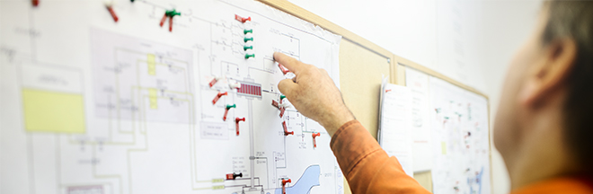 man explaining a technical diagram