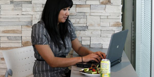 Woman working on her laptop during lunch