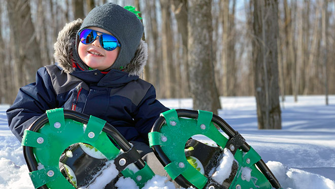 Image of child wearing snowshoes