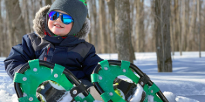 child wearing snowshoes