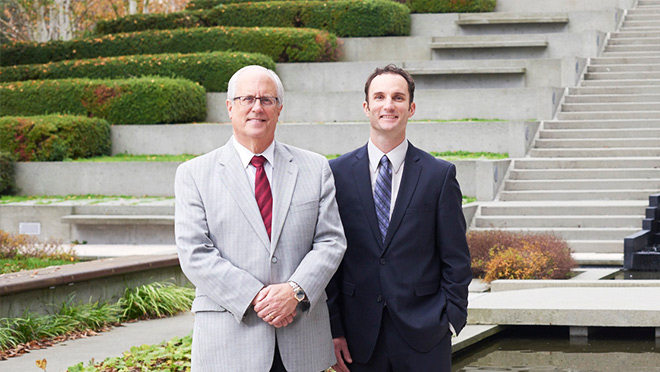 Photo of City of Richmond's Mayor Malcolm Brodie and corporate energy manager, Levi Higgs