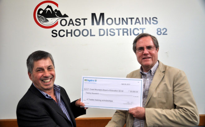 Bruce Barrett, vice-president of Transmission & Distribution Program Delivery, presents a cheque to Roger Leclerc, vice-chair of the Coast Mountains Board of Education.