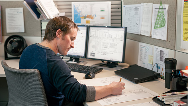 Image of design specialist sitting at a desk