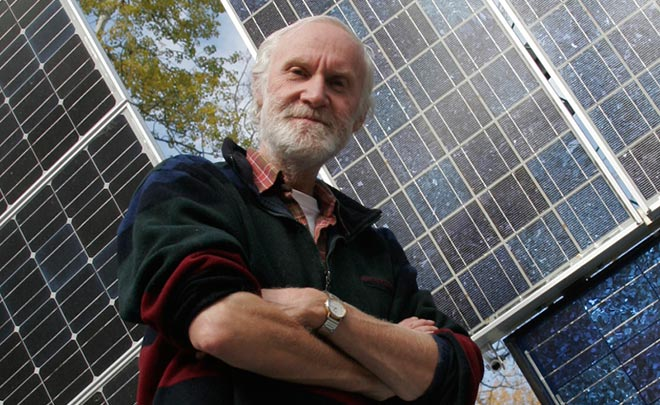 Don Pettit poses with solar panels he purchased for his home in the 1980s.
