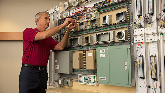 Image of instructor with electrical board