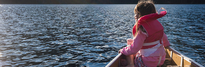 Image of girl with lifejacket in canoe