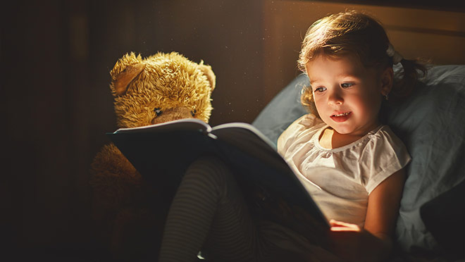 Image of young girl reading a book