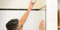 Man installing a low flow shower head