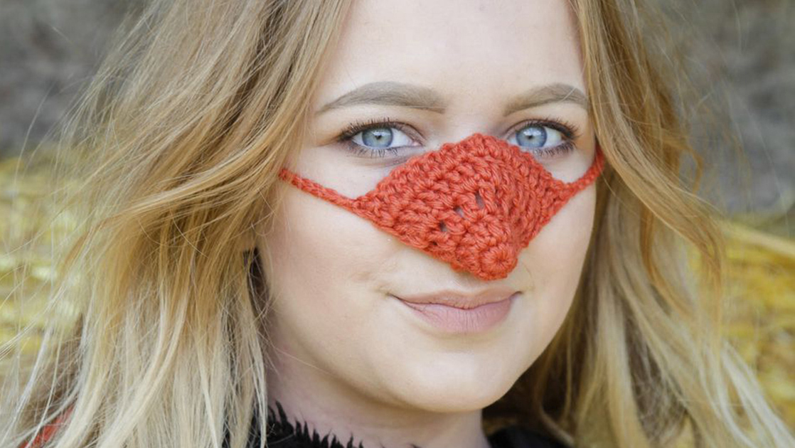 A woman wearing a knitted nose warmer