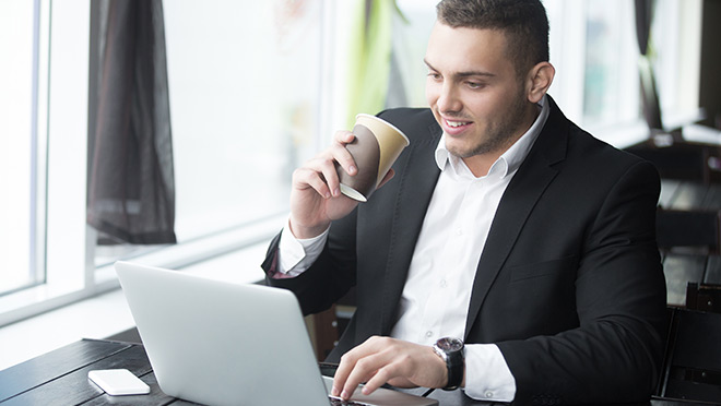 Image of businessman using a laptop