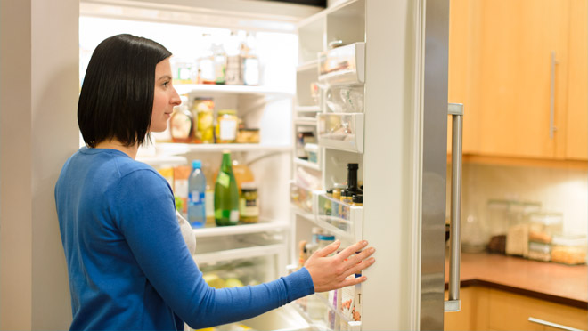 Woman looking in a fridge
