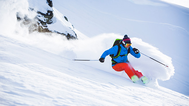 Image of woman skiing in fresh powder