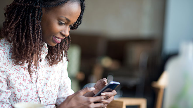 Image of a woman using a smartphone