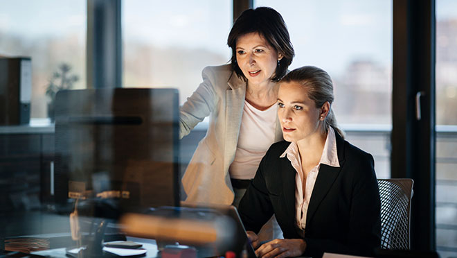 Image of two women working in an office