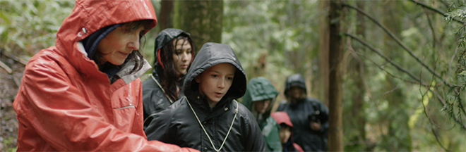 youth-rain-gear-forest-people-660x216.jpg