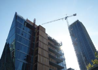 Commercial highrise building under construction with a crane