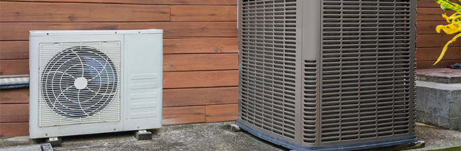 Photo of a ducted heat pump and a ductless heat pump