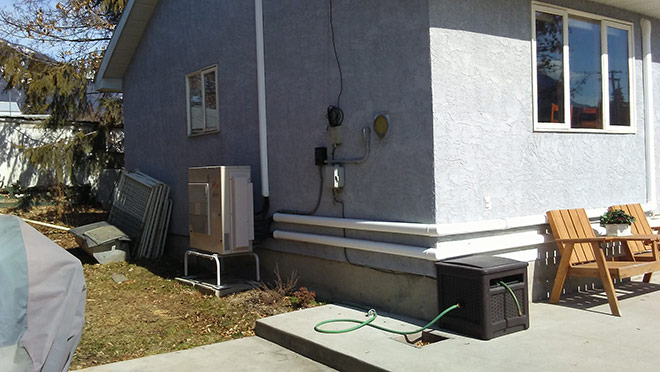 Image of a heat pump on a renovated Nakusp home