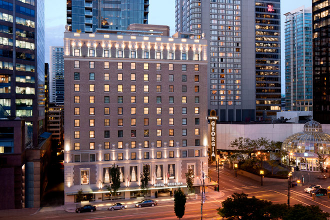Image of the exterior of the Rosewood Hotel Georgia at twilight