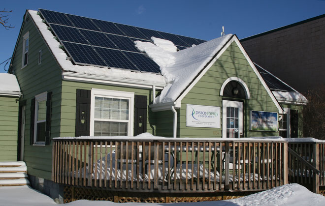 Solar panels cover the roof of a Dawson Creek office building